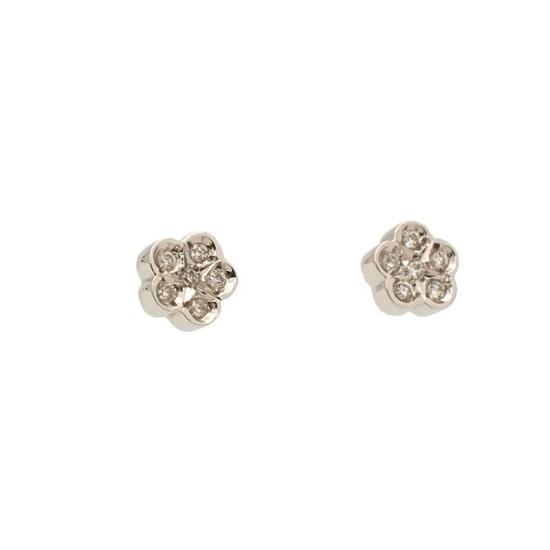 Pendientes de niña en oro blanco y diamantes con forma de flor